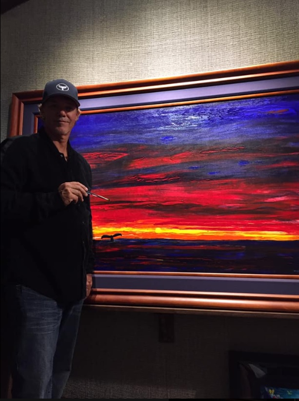 Wyland touching up our painting